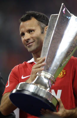 HOUSTON - JULY 28:  Ryan Giggs #11 of Manchester United holds the All-Star trophy following United's 5-2 win over the MLS All-Stars in the MLS All Star Game at Reliant Stadium on July 28, 2010 in Houston, Texas.  (Photo by Ronald Martinez/Getty Images)