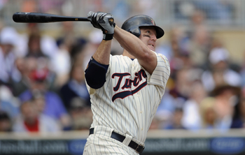 MINNEAPOLIS, MN - APRIL 24: Jim Thome #25 of the Minnesota Twins hits a double against the Cleveland Indians during the seventh inning of their game on April 24, 2011 at Target Field in Minneapolis, Minnesota. Twins defeated the Indians 4-3. (Photo by Han