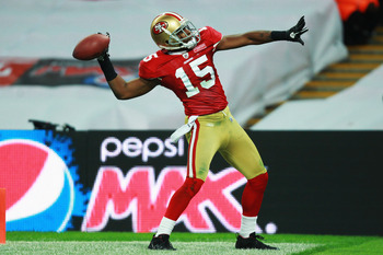 LONDON, ENGLAND - OCTOBER 31:  Michael Crabtree #15 of San Francisco 49ers celebrates as he scores their second touchdown during the NFL International Series match between Denver Broncos and San Francisco 49ers at Wembley Stadium on October 31, 2010 in Lo