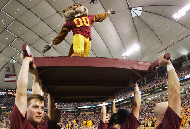 MINNEAPOLIS - OCTOBER 23:  Minnesota mascot 'Goldy' the gopher is hoisted up after a touchdown in the fourth quarter against Illinois at the Hubert H. Humphrey Metrodome on October 23, 2004 in Minneapolis, Minnesota. Minnesota defeated Illinois 45-0. (Pho