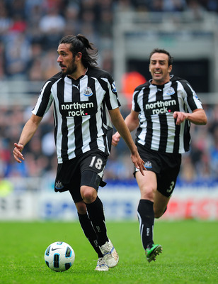 NEWCASTLE UPON TYNE, ENGLAND - MAY 07:  Newcastle player Jonas Gutierrez (l) and Jose Enrique bomb down the left flank during the Barclays  Premier League game between Newcastle United and Birmingham City at St James' Park on May 7, 2011 in Newcastle upon