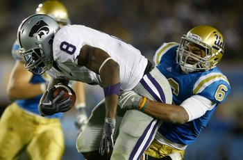 PASADENA, CA - SEPTEMBER 19:  Daniel Thomas #8 of the Kansas State Wildcats is tackled by Tony Dye #6 of the UCLA Bruins in the third quarter at the Rose Bowl on September 19, 2009 in Pasadena, California.  UCLA defeated Kansas State 23-9.  (Photo by Jeff
