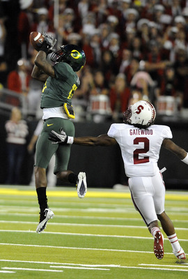 EUGENE, OR - OCTOBER 2: Cornerback Cliff Harris #13 of the Oregon Ducks intercepts a pass in front of cornerback Corey Gatewood #2 of the Stanford Cardinal in the third quarter of the game at Autzen Stadium on October 2, 2010 in Eugene, Oregon. Oregon won