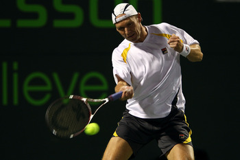 KEY BISCAYNE, FL - MARCH 24:  Rainer Schuettler of Germany hits a return against Ryan Harrison during the Sony Ericsson Open at Crandon Park Tennis Center on March 24, 2011 in Key Biscayne, Florida.  (Photo by Clive Brunskill/Getty Images)