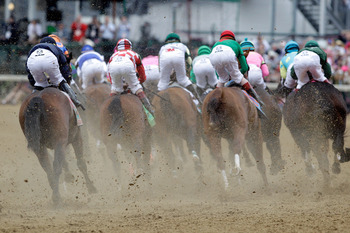 LOUISVILLE, KY - MAY 07:  Jockeys and horses race around turn one during the 137th Kentucky Derby at Churchill Downs on May 7, 2011 in Louisville, Kentucky.  (Photo by Rob Carr/Getty Images)