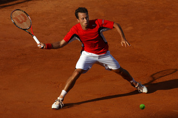 ROME, ITALY - MAY 11:  Phillip Kohlschreiber of Germany plays a forehand return during his second round defeat to Feliciano Lopez of Spain during day four of the Internazionali BNL d'Italia at the Foro Italico Tennis Centreon May 11, 2011 in Rome, Italy.
