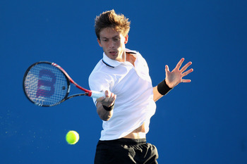 MELBOURNE, AUSTRALIA - JANUARY 19:  Nicolas Mahut of France plays a forehand during his second round match against Viktor Troicki of Serbia during day three of the 2011 Australian Open at Melbourne Park on January 19, 2011 in Melbourne, Australia.  (Photo