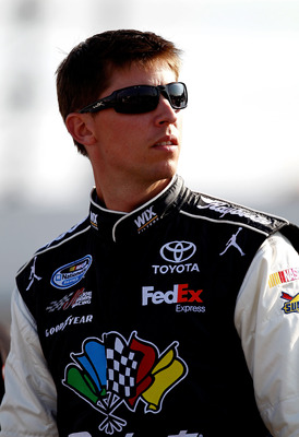 DARLINGTON, SC - MAY 06:  Denny Hamlin, driver of the #11 Sport Clips Toyota, stands on the grid during qualifying for the NASCAR Sprint Cup Series SHOWTIME Southern 500 at Darlington Raceway on May 6, 2011 in Darlington, South Carolina.  (Photo by Jeff Z