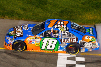 RICHMOND, VA - APRIL 30:  Kyle Busch, driver of the #18 M&M's Pretzel Toyota, celebrates after winning the NASCAR Sprint Cup Series Crown Royal Presents The Matthew & Daniel Hansen 400 at Richmond International Raceway on April 30, 2011 in Richmond, Virgi