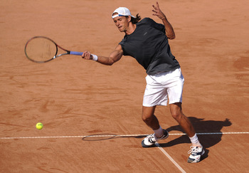 BUCHAREST, ROMANIA - SEPTEMBER 23:  Ruban Ramirez Hidalgo of Spain in action against Marius Copil of Romania during Round Two of the BCR Open Romania at the BNR Arena on September 23, 2009 in Bucharest, Romania.  (Photo by Christopher Lee/Getty Images)
