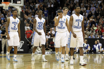 NEWARK, NJ - MARCH 27:  Leslie McDonald #2, Harrison Barnes #40, Kendall Marshall #5, Tyler Zeller #44 and Dexter Strickland #1 of the North Carolina Tar Heels walks of the court after being defeated by the Kentucky Wildcats in the east regional final of