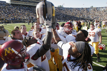 ANN ARBOR - OCTOBER 8:  The Minnesota Gophers celebrate their win after the game against the Michigan Wolverines at Michigan Stadium on October 8, 2005 in Ann Arbor, Michigan.  The pass was incomplete. Minnesota won 23-20. (Photo by Tom Pidgeon/Getty Imag