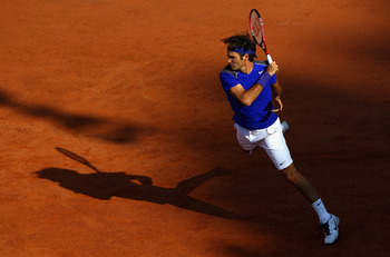 ROME, ITALY - MAY 12:  Roger Federer of Switzerland in action during his third round match against Richard Gasquet of France during day five of the Internazoinali BNL D'Italia at the Foro Italico Tennis Centre on May 12, 2011 in Rome, Italy.  (Photo by Cl
