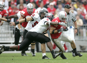 COLUMBUS, OH - SEPTEMBER 2:  Split end Anthony Gonzalez #11 of the Ohio State University Buckeyes is tackled by linebacker Josh Allen #9 of the Northern Illinois University Huskies during the game on September 2, 2006 at Ohio Stadium in Columbus, Ohio. OS
