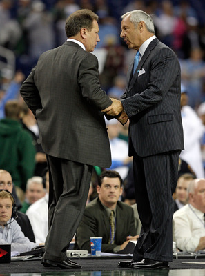 DETROIT - DECEMBER 03:  Roy Williams the Head Coach of the North Carolina Tar Heels and Tom Izzo the Head Coach of the Michigan State Spartans greet after the game against on December 3, 2008 at Ford Field in Detroit, Michigan.  (Photo by Andy Lyons/Getty