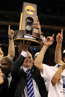 HOUSTON, TX - APRIL 04:  Head coach Jim Calhoun of the Connecticut Huskies celebrate with his team and the trophy after defeating the Butler Bulldogs to win the National Championship Game of the 2011 NCAA Division I Men's Basketball Tournament by a score