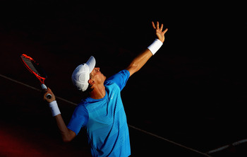 ROME, ITALY - MAY 13:  Tomas Berdych of Czech Republic serves during his quarter final match against Richard Gasquet of France during day six of the Internazoinali BNL D'Italia at the Foro Italico Tennis Centre  on May 13, 2011 in Rome, Italy.  (Photo by