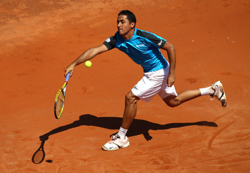 ROME, ITALY - MAY 10:  Nicolas Almagro of Spain plays a forehand return during the his first round match against Simone Bolelli of Italy during day three of the Internazionali BNL d'Italia at the Foro Italico Tennis Centre on May 10, 2011 in Rome, Italy.