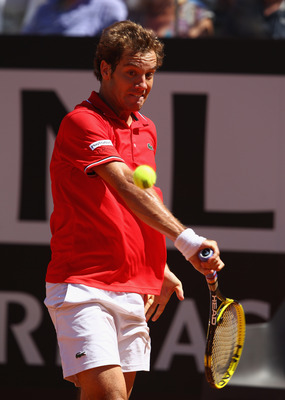 ROME, ITALY - MAY 14:  Richard Gasquet of France  plays a backhand during his semi final match against  Rafael Nadal of Spain during day seven of the Internazoinali BNL D'Italia at the Foro Italico Tennis Centre  on May 14, 2011 in Rome, Italy.  (Photo by