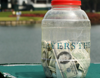 PONTE VEDRA BEACH, FL - MAY 11:  The money jar for the 'Caddie Challenge' is seen on the 17th hole during a practice round prior to the start of THE PLAYERS Championship held at THE PLAYERS Stadium course at TPC Sawgrass on May 11, 2011 in Ponte Vedra Bea