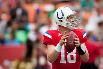 HONOLULU - JANUARY 30:  Peyton Manning, #18 of the Indianapolis Colts, looks for an open reciever during the 2011 NFL Pro Bowl at Aloha Stadium on January 30, 2011 in Honolulu, Hawaii. NFC won 55-41 over the AFC. (Photo by Kent Nishimura/Getty Images)