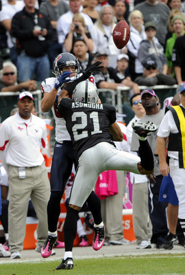 OAKLAND, CA - OCTOBER 3:  Defensive back Nnamdi Asomugha #21 of the Oakland Raiders breaks up a pass to wide receiver Kevin Walter #83 of the Houston Texans during an NFL football game October 3, 2010 at The Oakland-Alameda County Coliseum in Oakland, Cal