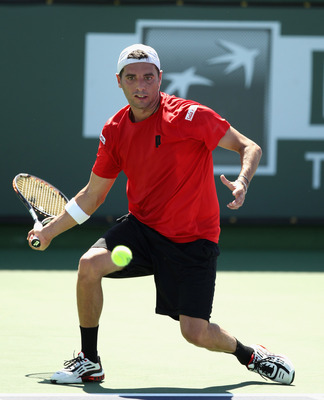 INDIAN WELLS, CA - MARCH 12:  Albert Montanes of Spain in action against Jarkko Nieminen of Finland during the BNP Paribas Open at the Indian Wells Tennis Garden on March 12, 2011 in Indian Wells, California.  (Photo by Ezra Shaw/Getty Images)