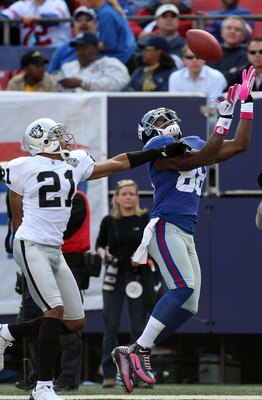 EAST RUTHERFORD, NJ - OCTOBER 11:  Hakeem Nicks #88 of the New York Giants attempts a catch against Nnamdi Asomugha #21 of the Oakland Raiders on October 11, 2009 at Giants Stadium in East Rutherford, New Jersey. The Giants defeated the Raiders 44-7.  (Ph