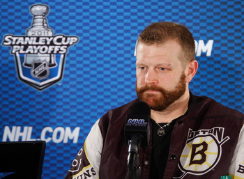 TAMPA, FL - MAY 19:  Tim Thomas #30 of the Boston Bruins speaks to the media after their 2 to 0 victory over the Tampa Bay Lightning in Game Three of the Eastern Conference Finals during the 2011 NHL Stanley Cup Playoffs at St Pete Times Forum on May 19,