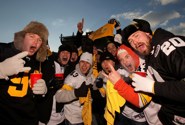 PITTSBURGH, PA - JANUARY 23:  Fans of the Pittsburgh Steelers pose for a photo as they tailgate outside the stadium prior to the 2011 AFC Championship game against the New York Jets at Heinz Field on January 23, 2011 in Pittsburgh, Pennsylvania.  (Photo b