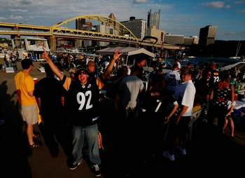 PITTSBURGH - SEPTEMBER 10:  Fans tailgate outside Heinz Field before the NFL season opener between the Pittsburgh Steelers and the Tennessee Titans on September 10, 2009 in Pittsburgh, Pennsylvania. (Photo by Scott Boehm/Getty Images)