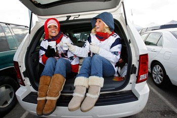 FOXBORO, MA - JANUARY 20:  New England Patriots fans Jaime Canty and Lisa Capone of Swampscott, Massachusetts tailgate before the AFC Championship Game agianst the San Diego Chargers on January 20, 2008 at Gillette Stadium in Foxboro, Massachusetts.  (Pho