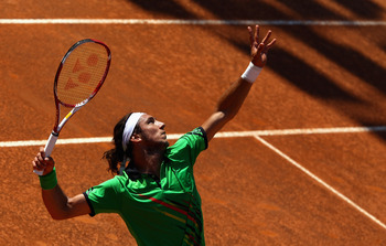 ROME, ITALY - MAY 10: Juan Monaco of Argentina  serve during his second round match against Tomas Berdych of Czech Republic during day three of the Internazoinali BNL D'Italia at the Foro Italico Tennis Centre on May 10, 2011 in Rome, Italy.  (Photo by Cl
