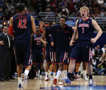 ANAHEIM, CA - MARCH 24:  Kyryl Natyazhko #1 celebrates with Jamelle Horne #42 of the Arizona Wildcats as he walks towards the bench against the Duke Blue Devils during the west regional semifinal of the 2011 NCAA men's basketball tournament at the Honda C