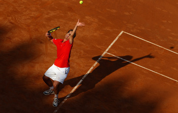 ROME, ITALY - MAY 12:  Richard Gasquet of France  serves during his third round match against Roger Federer of Switzerland during day five of the Internazoinali BNL D'Italia at the Foro Italico Tennis Centre on May 12, 2011 in Rome, Italy.  (Photo by Cliv
