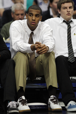 DENVER, CO - MARCH 17:  Brandon Davies of the Brigham Young Cougars looks on from the bench as his team takes on the Wofford Terriers during the second round of the 2011 NCAA men's basketball tournament at Pepsi Center on March 17, 2011 in Denver, Colorad