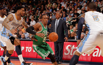 DENVER, CO - FEBRUARY 24:  Rajon Rondo #9 of the Boston Celtics controls the ball against Ty Lawson #3, Wilson Chandler #21 and J.R. Smith #5 of the Denver Nuggets as head coach Doc Rivers of the Celtics looks on during NBA action at the Pepsi Center on F