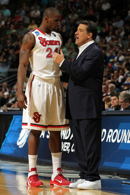 DENVER, CO - MARCH 17:  Head coach Steve Lavin of the St. John's Red Storm talks with Justin Burrell #24 against the Gonzaga Bulldogs during the second round of the 2011 NCAA men's basketball tournament at Pepsi Center on March 17, 2011 in Denver, Colorad