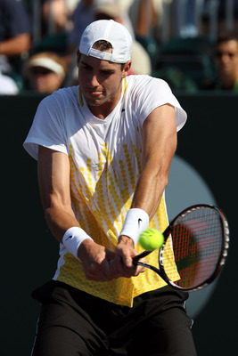 KEY BISCAYNE, FL - MARCH 27:  John Isner gets set to hit a backhand return against Alex Bogomolov Jr. during the Sony Ericsson Open at Crandon Park Tennis Center on March 27, 2011 in Key Biscayne, Florida.  (Photo by Clive Brunskill/Getty Images)
