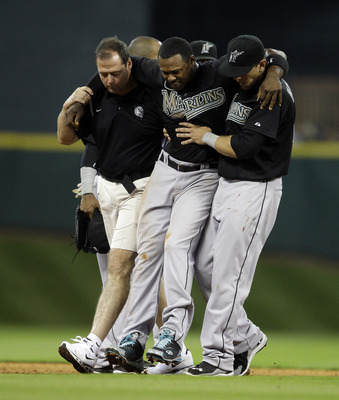 HOUSTON - APRIL 08:  Shortstop Hanley Ramirez #2 of the Florida Marlins has to be helped off the field after Bill Hall #22 of the Houston Asrtros slid into second base to interupt the double play at Minute Maid Park on April 8, 2011 in Houston, Texas.  (P