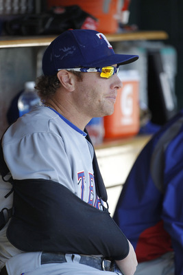 DETROIT - APRIL 13:  Josh Hamilton #32 of the Texas Rangers watches the action from the dugout during the game against the Detroit Tigers at Comerica Park on April 13, 2011 in Detroit, Michigan.  (Photo by Leon Halip/Getty Images)