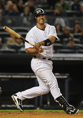 NEW YORK, NY - MAY 15:  Jorge Posada #20 of the New York Yankees reacts after missing a pitch against the Boston Red Sox during their game on May 15, 2011 at Yankee Stadium in the Bronx borough of New York City.  (Photo by Al Bello/Getty Images)