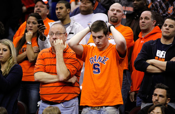 CLEVELAND, OH - MARCH 20: The Syracuse Orange fans look on after their team was defeated by the Marquette Golden Eagles during the third of the 2011 NCAA men's basketball tournament at Quicken Loans Arena on March 20, 2011 in Cleveland, Ohio.  (Photo by G