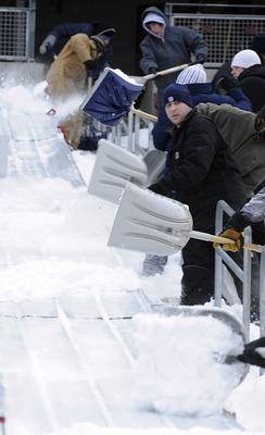 MINNEAPOLIS, MN - DECEMBER 15: Workers shovel snow on to a slide that brought the snow down to field level as TCF Bank Stadium prepares for a potential monday night football game between the Minnesota Vikings and Chicago Bears on December 15, 2010 in Minn