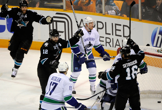 SAN JOSE, CA - MAY 20:  Patrick Marleau #12 of the San Jose Sharks reacts after his first of two first period goals as Christian Ehrhoff #5 of the Vancouver Canucks looks on in Game Three of the Western Conference Finals during the 2011 Stanley Cup Playof