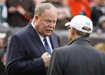 CLEVELAND - NOVEMBER 14:  Owner Woody Johnson of the New York Jets talks with general manager Mike Holmgren of the Cleveland Browns prior to the start of their game at Cleveland Browns Stadium on November 14, 2010 in Cleveland, Ohio.  (Photo by Matt Sulli