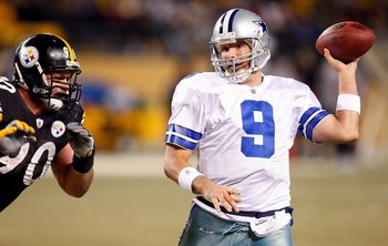Travis Kirschke running down Tony Romo, forcing him to throw left handed