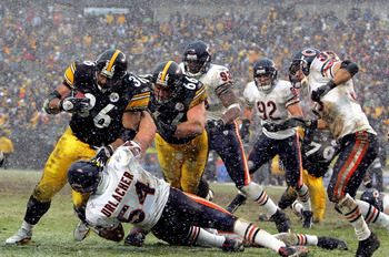 Jerome Bettis running over Brian Urlacher on his way to finding the endzone