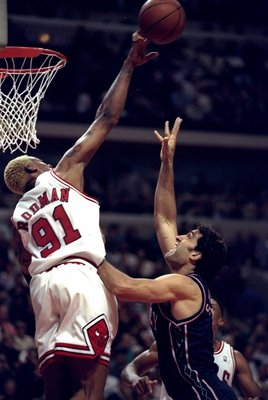 26 Apr 1998:  Dennis Rodman #91 of the Chicago Bulls and Rony Seikaly #2 of the New Jersey Nets jump for the ball during a First Round Playoff Game at the United Center in Chicago, Illinois. The Bulls defeated the Nets 96-91.