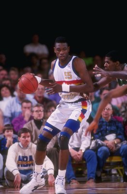 1991-1992:  Center Dikembe Mutombo of the Denver Nuggets moves the ball during a game at the McNichols Sports Arena in Denver, Colorado. Mandatory Credit: Tim DeFrisco  /Allsport Mandatory Credit: Tim DeFrisco  /Allsport